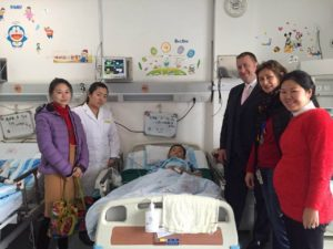 James Colclough and Connie Li visit Zhang San our second beneficiary of Chi Fan for Charity